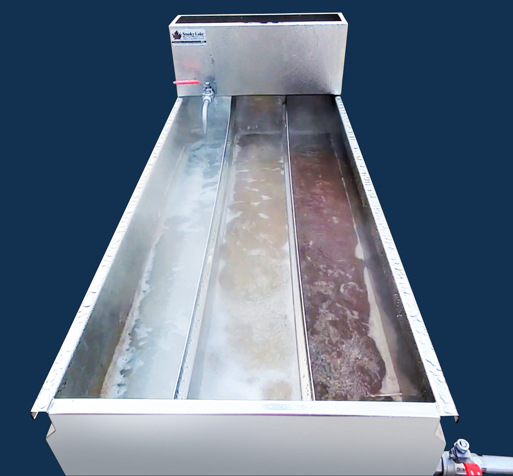 """Great example of a """"gradient"""" in a continuous flow pan. The sap closest to the draw off is the most condensed."""