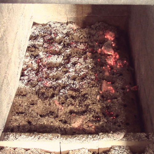 After running the evaporator hard for 3 hours, there were very few ashes left in the firebox. The 'holes' in the ashes indicate locations where air had been injected by the blowers.